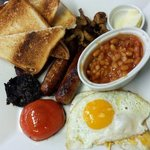 Full english breakfast heinz baked beans honey roast pork sausages, bacon and toast from uk too,
