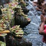 people pray at the pool in Istana Tampaksiring