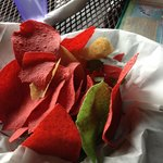 Florescent red and green corn tortilla chips
