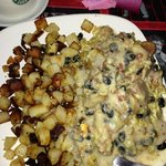 Hank's Cajun Girl.......  Andouille, black bean & cheddar scrambled eggs over jalepeno corn brea