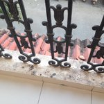 Pigeon poo all over the balcony - not cleaned off!