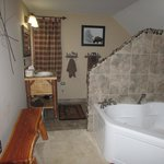 The lovely bathroom with a whirlpool/jetted 2 person tub.