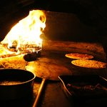 kiln baking pizza and carne