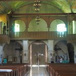 Looking back down the aisle at the main entrance and choir loft