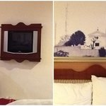 lcd tv and headboard on the bed