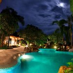 Pool as seen at night with view of Family suite on the left. Photo by, Hamish Humphreys