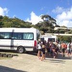 Congregating around campervan in concrete jungle.