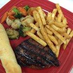 Flat Iron steak, grilled veggies,fries and garlic breadstick.