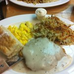 Country fried steak, scrambled eggs, hashbrowns, biscuits