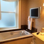 Bathtub and tv in our bathroom