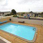 In ground solar heated swimming pool
