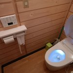 Cozy toilet which is kept spotlessly clean at all times.