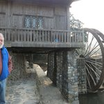 The water wheel at the mid span of the river