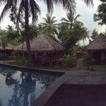Panorama taking in beach, pool, bungalos, dining area and spa