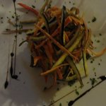 Layered aubergines topped with deep fried julienne vegetables