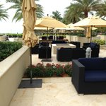 Seating area on back patio (ocean on left, hotel on right).  Plenty of seats and umbrellas