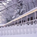 The Inn's porch is transformed when it snows