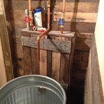 Exposed Plumbing in Bathroom