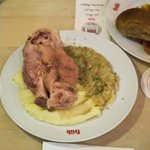 Boiled pork knuckle with sauerkraut and mashed potatoes.