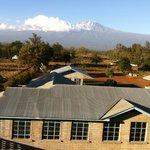 Room's balcony view of Mt. Kilimanjaro and Mailisita School (foreground)