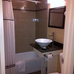 Very Clean and modern.  Shower roomy due to wide shower curtain rod