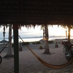The view at sunset from inside the room, notice the hammocks!