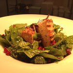 grilled salmon fillets with spinach and pomegranate..