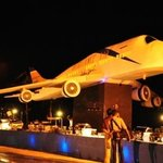 The mock up of the aircraft on the beach with buffet tables below