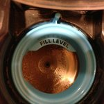 Dirty water tank in coffee maker - shiny area was the part I wiped off.