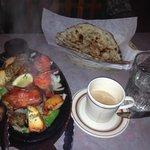 Exotic grill sampler, chai tea, stuffed naan, and basmati rice.