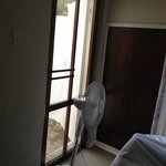 Door leading out from the 2nd bedroom to enclosed concrete strip