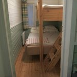 Tiny cell-like bedroom for 3!