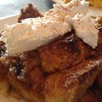 Pumpkin spice egg nog french toast topped with cinnamon whipped cream!