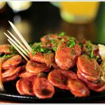 CALABREZA / Pan fried brazilian sausage with onions.