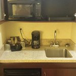 Mini fridge, microwave, sink in kitchenette.  All clean