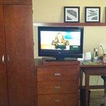Tv, closet, dresser, desk with chair