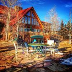 After a winter hike, relaxing in front of the cabin