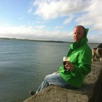 Enjoying a pint on the seawall.