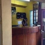 Front desk, receptionist on phone
