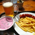 Cold beer, great cold soup, and a decent sausage with fries