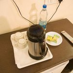cofee or tea maker with biscuts and water bottle