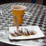 Mini pancakes covered in powdered sugar & hot chocolate