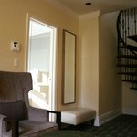 Living room w/spiral staircase in turret suite