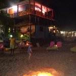 Fire pit for diners on the beach at night