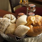 Basket of fresh bread served at the Breakfast Rome of dei Borgognoni hotel in Rome