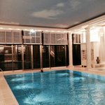 The hotel's stunning swimming pool with painted sky on ceiling