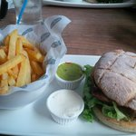 A tasty burger with chicken.