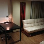 nice sized working desk and sofa-bed