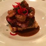 smoked pork shoulder with grilled shrimp and polenta cake