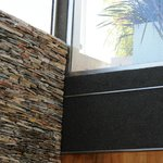 Stylish design includes amazing walls of layered stone